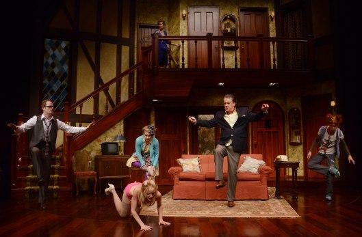 Upstairs: Garret Long. Downstairs (l to r): Noah Plomgren, Laura Woyasz, Helena Ruoti, Preston Dyar, Karen Baum. Photo courtesy of Pittsburgh Public Theater.